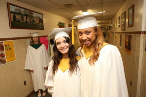 OLMA Graduation: Victoria Giansante, 18 , left of Mays Landing and Sedona Hill, 17 of Simthville , right pose together before their Graduation at Our Lady of Mercy Academy Tuesday May 27, 2014. - Edward Lea