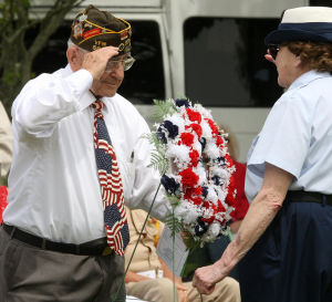 : Al Mouklas of VFW Post 5941 in North Wildwood, presents a wreath during the ceremony. Memorial Day services held at Veterans Cemetery in Crest Haven, Middle Township. Monday May 27, 2013. (Dale Gerhard/The Press of Atlantic City)  - Dale Gerhard