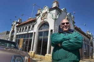 Deco: Building owner Merrill Kelem, of Ventnor, stands at the site with the original Studebaker logos still adorning the building.  - Ben Fogletto