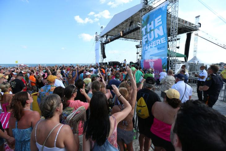 Mac McAnally performs on stage at a free concert held on the beach in front Resorts Maragaritaville in Atlantic City with special guest Jimmy Buffet