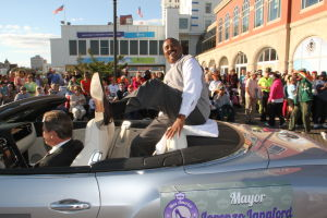MISS AMERICA PARADE: Atlantic City Mayor Lorenzo Langford shows off his shoe during Miss America parade on Atlantic City Boardwalk Saturday. - Edward Lea