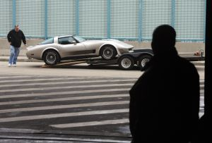 Ac Car Show: Bob Palmer, of Pennauken supervises as his son, John Palmer , also of Pennsauken, backs Bob's 1982 Corvette Collector off a trailer to bring into the hall. Cars begin to arrive at the Atlantic City Convention Center for the AC Car Show. Wednesday, February, 27, 2013( Press of Atlantic City/ Danny Drake)  - Danny Drake