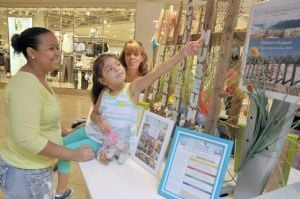 Jersey Shore Children's Museum Begins Fundraisers To Help Retrofit New Facility: Szypula gave information about the South Jersey Children's Museum's to Shima Rosario, of Somers Point, and her 4-year-old daughter, Jayla.