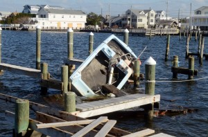 Missing Boats: A small boat is wedged into the pilings of a dock on 27th Street, in Ship Bottom, by Hurricane Sandy. Wednesday, November,21, 2012( Press of Atlantic City/ Danny Drake)  - Photo by Danny Drake
