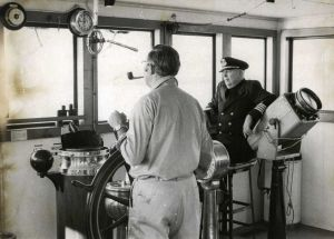 Cape May-Lewes Ferry 15.jpg: January 27, 1974. VIEW FROM THE BRIDGE. Capt. Albert T. Morris, right, keeps lookout from the pilot house of the Cape May-Lewes ferry. Historical photo archives.