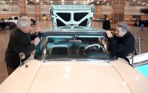 Ac Car Show: Car owner, Tony Averso, of Ortley Beach, N.J., and show manager, John Chiara, of Cherry Hill, raise the roof of Chiara's 1959 Ford Retractible. Cars begin to arrive at the Atlantic City Convention Center for the AC Car Show. Wednesday, February, 27, 2013( Press of Atlantic City/ Danny Drake)  - Danny Drake