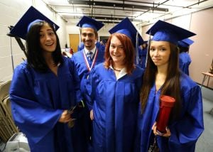 CHARTER TECH. GRADUATION: Caylie Karstens, 18, left of Egg Harbor Township Emilio Gonzalez, 18 of Plesasantville Abigail McKay, 17 of Brigantine and Jessica Paulsson, 18, right of Absecon pose for a photo before the start of Charter-Tech High School Graduation at Tighe School Performing Arts Center in Margate Friday, June 20, 2014. - Edward Lea