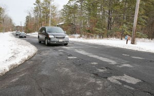 Pothole Map: Cars travel through potholes on Old Harding Highway and Reading in Mays Landing. Tuesday March 4 2014 (The Press of Atlantic City / Ben Fogletto) - Ben Fogletto