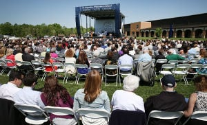ST. AUGUSTINE GRADUATION: Family members fill the seats in front of the stage. The event was held outside on campus. Sunday May 18 2014 St. Augustine Prep Graduation. (The Press of Atlantic City / Ben Fogletto) - Ben Fogletto
