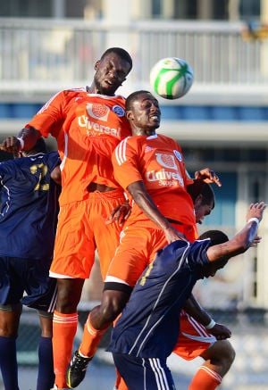 Ocean City Nor'easters: The Nor'easters' Tapiwa Machingauta, left, and Ricardo Isreal leap over Reading United's Darius Madison to try to head the ball during their Premier Development League game Sunday at Carey Stadium in Ocean City. - Photo by Ben Fogletto