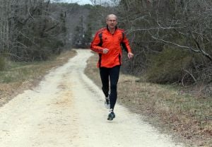 Boston: Tom Flournoy, one of the Boston marathoners, is going for a training run on the FAA base Friday April 18, 2014. - Edward Lea