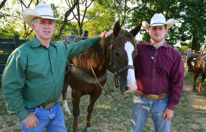 Butch Days Rodeo: Butch Dase (left) and his son Travis at his Bridgeton ranch. Monday September 30 2013 Butch Dase and his son Travis Dase are competing in the Team Roping competition at the Atlantic City Boardwalk Rodeo this weekend. (The Press of Atlantic City / Ben Fogletto) - Ben Fogletto