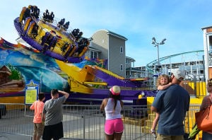 Park Rides: People watch the newly installed Tropical Thunder ride in operation. Saturday June 22 2013 Rides at Playland Castaway Cove in Ocean City. (The Press of Atlantic City / Ben Fogletto)  - Ben Fogletto