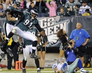 Cox Photo: The Eagles' Fletcher Cox (91) celebrates after sacking Cowboys quarterback Tony Romo on Nov. 11 in Philadelphia.  - Photo by Michael Perez