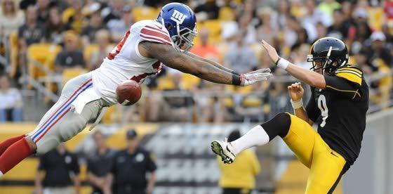 Rookie DE Moore impresses Giants