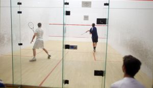 St. Augustine Squash Match: St. Augustine's Austin King, 18 of Harbor Township, right plays against St. Joe Prep of Philadelphia Liam Casey, 17 of Philadelphia, left during squash match at Greate Bay Racquet & Fitness in Somers Point Tuesday, Feb, 18, 2014. - Edward Lea