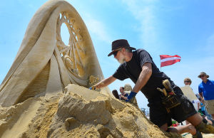 SAND SCULPTING: Sculptor Jeff Strong of Puget Sound Washington State works on his entry. Sunday June 16 2013 World Championship of Sand Sculpting on the beach next to the Pier at Caesars in Atlantic City. (The Press of Atlantic City / Ben Fogletto)  - Photo by Ben Fogletto