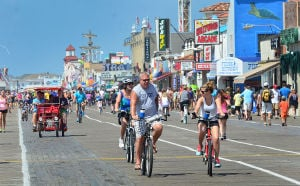JL08 Holiday Weekend: People ride bikes near 7th Street in Ocean City on the Boardwalk. Sunday July 7 2013 4th of July Weekend in Ocean City. (The Press of Atlantic City / Ben Fogletto) - Ben Fogletto