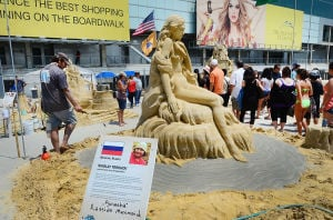 SAND SCULPTING: Sculptor Nikoloy Torkhov of Moscow, Russia works on his entry. Sunday June 16 2013 World Championship of Sand Sculpting on the beach next to the Pier at Caesars in Atlantic City. (The Press of Atlantic City / Ben Fogletto)  - Photo by Ben Fogletto