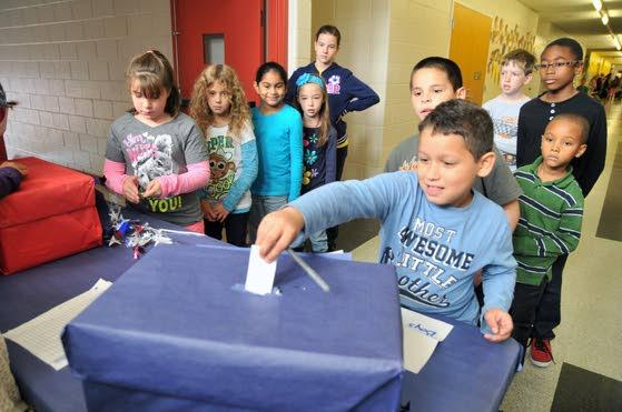 Hess Complex students cast ballots as homerooms stand in for states
