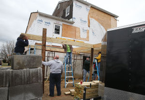 GB A21 LTRG: Tuesday April 8 2014 Volunteers from the county Long Term Recovery Group work on a house owned by Sarah Huff in Brigantine damaged by Hurricane Sandy. (The Press of Atlantic City / Ben Fogletto) - Ben Fogletto