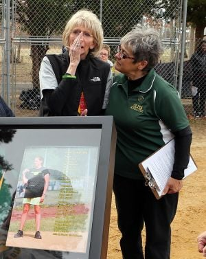 OLMA Softball: Geri Patrick , left of Georgia mother of former softball coach Jamie Cook who died suddenly over the winter at a young age thank AD Michelle McGrath, right of Our Lady of Marcy Academy during the ceremony to honor her daughter Tuesday, April 8, 2014. - Edward Lea