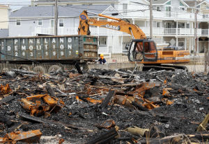 SIC Fire Folo: A demolition permit was issued and work has begun on removing the burned out remains of a home that was part of the three house fire on the 7800 beach block of Sea Isle City last month. Friday May 2, 2014. (Dale Gerhard/Press of Atlantic City) - Dale Gerhard