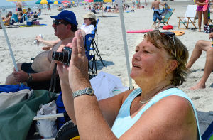 Airshow Practice: Denise Hubicki of Mantua NJ takes pictures of the planes near Florida Avenue. Tuesday June 25 2013 Atlantic City AirShow practice. (The Press of Atlantic City / Ben Fogletto) - Ben Fogletto