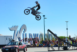 ROAR TO THE SHORE: Stunt biker Scott Hanlon performs motorcycle stunts. Saturday September 7 2013 Tens of thousands of motorcycles gather in Wildwood this weekend for the annual Roar to the Shore. (The Press of Atlantic City / Ben Fogletto) - Ben Fogletto