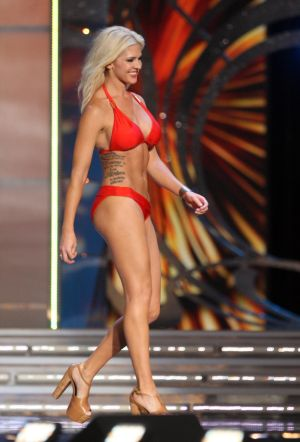 Miss America 1 PRELIMS: Miss Kansas Theresa Vail takes part in the swimsuit portion during the first night of Miss America competition Tuesday at Boardwalk Hall Atlantic City Tuesday. Officials said she was the first contestant ever to have shown tattoos during Miss America competition. - Photo by Edward Lea