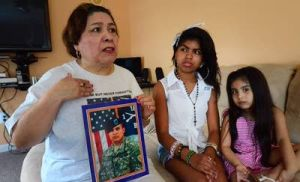 Vet 1: Eric's mother Cayetana Palacios talks about Eric next to his nieces, Emily, 12, and Erika Rivera, 5.  - Ben Fogletto