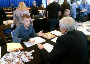 Vet Job Fair: Marine Corps veteran, Tully O'Clisham, of Sea Isle, talks with Trico Equipment Services VP of Purchasing Asset Management, Bob Buker, of Mystic Island, at the job fair. A job fair, at the Ocean City Music Pier, especially geared to military veterans, who experience a much higher unemployment rate than the general working population. It's the latest of several initiatives to help veterans re-enter the workforce. Thursday, October, 11, 2012, 2012 ( Press of Atlantic City/ Danny Drake)
