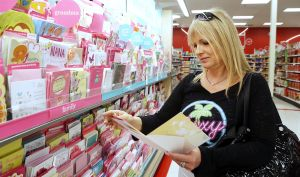 Mother's Day Cards: Trasena Monroe of Egg Harbor Township looking for a Mother's Day card at Target in Mays LandingTuesday May 6, 2014. - Edward Lea