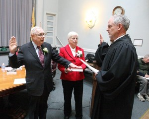Cape Reorganization: Judge Louis J. Belasco, right, swears in Edward J. Mahaney to a four-year term as mayor Tuesday at City Hall in Cape May. Mahaney was joined by his sister Patricia Brand.  - Photo by Edward Lea