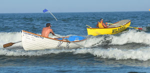 Tri-Resorts: Upper's Joe O'Neil and Wildwood's Ed Schneider finish the Singles Row. Monday July 15 2013 Tri-Resorts Lifeguard Championships in Strathmere. (The Press of Atlantic City / Ben Fogletto) - Ben Fogletto