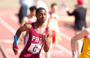 Relays28-r: 2013 Penn Relays Saturday April 27th, Pleasantville's Isaac Clark runs the second leg in the High School Boys' 4x800 Championship of America, Pleasantville won the race. ( ED HILLE / Staff Photographer )  - Ed Hille