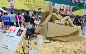 SAND SCULPTING: Sculptor David Ducharme of Nelson BC, Canada works on his entry. Sunday June 16 2013 World Championship of Sand Sculpting on the beach next to the Pier at Caesars in Atlantic City. (The Press of Atlantic City / Ben Fogletto)  - Ben Fogletto