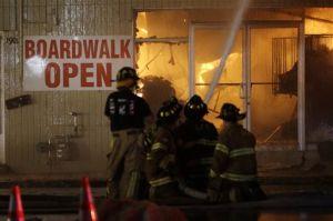 APTOPIX NJ Boardwalk Fire: Firefighters battle a blaze in a building on the Seaside Park boardwalk on Thursday, Sept. 12, 2013. - Julio Cortez