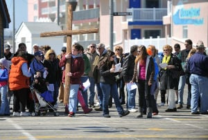 Station Of The Cross: Devin Mulloy, 16, of the Bargaintown section of Egg Harbor Township, carries a wooden cross, Friday March 29, 2013, on the Ocean City Boardwalk. Members of St. John Lutheran Church of Ocean City held the event. (The Press of Atlantic City/Staff Photo by Michael Ein)  - Michael Ein