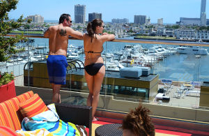H2O POOL AND BAR: Dr. Joseph Natoli and Lauren Nelson, both of Philadelphia, look at the view of the marina and atlantic City skyline from poolside. Saturday June 22 2013 H20 Pool and Bar at Golden Nugget Atlantic City. (The Press of Atlantic City / Ben Fogletto)  - Ben Fogletto