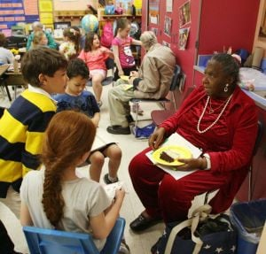 SS NORTHFIELD SENIORS: Senior citizen Bernice Garrett of Absecon take part in special program to matching students with the seniors at Northfield Community School Friday. - Edward Lea