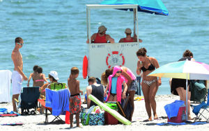 Heatwave: People crowd the beach in Atlantic City to escape the heat on Monday. - Ben Fogletto