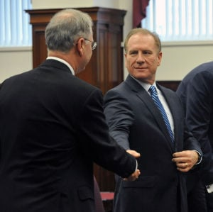 Hartmann: Jeff Hartmann, Interim Chief Executive Officer at Revel, right, shakes hands with Jack Adams, Deputy Attorney General, Tuesday March 19, 2013, following a special meeting with the Casino Control Committee to allow him to operate in Atlantic City. (The Press of Atlantic City/Staff Photo by Michael Ein)  - Michael Ein