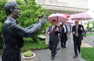 Parks 2: Jeff Alrecht (center) general manager of the Sheraton and Tom Scannapieco, (right) developer and owner of the Sheraton in Atlantic City, walk in the tea garden near the Bert Parks Statue. The bronze statue of Miss America icon Bert Parks, was reinstated in the Tea Garden outside the Sheraton Hotel in Atlantic City, Friday June 7, 2013. (Dale Gerhard/The Press of Atlantic City)  - Dale Gerhard