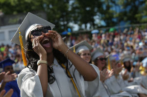 Oakcrest Graduation: Hunter Jenkins, 18, of Mays Landing, cheers during the Oakcrest High School graduation, Friday June 20, 2014, in Mays Landing. - Michael Ein
