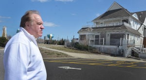 """Rundown Showhouse: Rich Potts walks past the run-down former """"Showhouse at the Shore"""" on North Carolina Avenue in Atlantic City being considered for convertion into transitional housing for ex-offenders. Friday March 29 2013 (The Press of Atlantic City / Ben Fogletto)  - Ben Fogletto"""