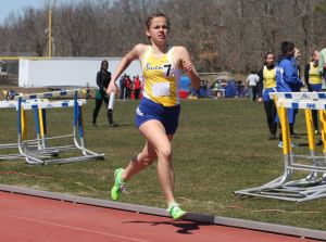 Buena Track And Field: Lisa Testa, 16, helps Buena Regional High School win a sprint medley race Saturday at the Buena Relays.  - Edward Lea