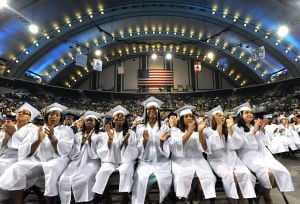 ATLANTIC CITY GRADUATION: Grads applaud Wednesday during the Atlantic City High School graduation ceremony at Boardwalk Hall in Atlantic City.  - Michael Ein