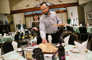 PASSOVER: Rabbi Avrohom Rapoport (Rabbi of the Chabad) and his daughter, Ella, 5, set out traditional Matzo for the Passover meal at Rodef Shalom Synogogue in Atlantic City. (The Press of Atlantic City / Ben Fogletto) - Ben Fogletto