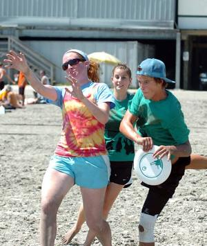 With 400 teams in action, sand, discs, bodies all fly